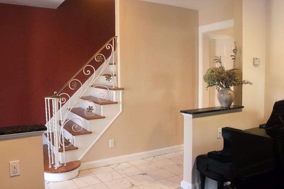 Warm gray wall paint - Adding Pizazz To An Entrance And Stairway Miriam Stern